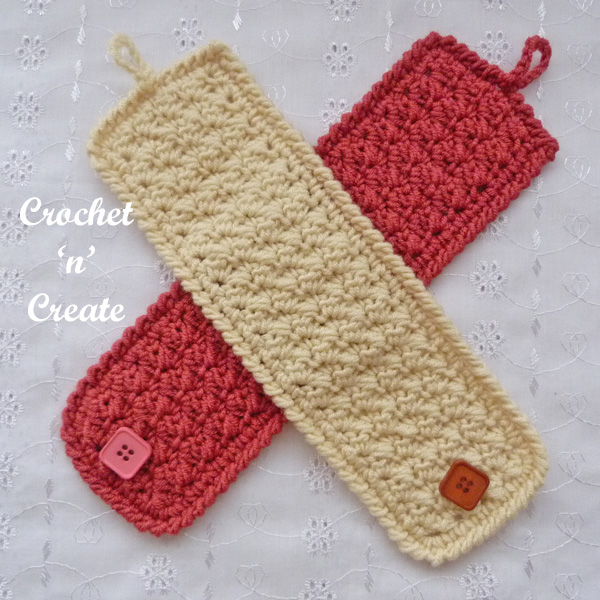 Simple textured mug cozy crossed