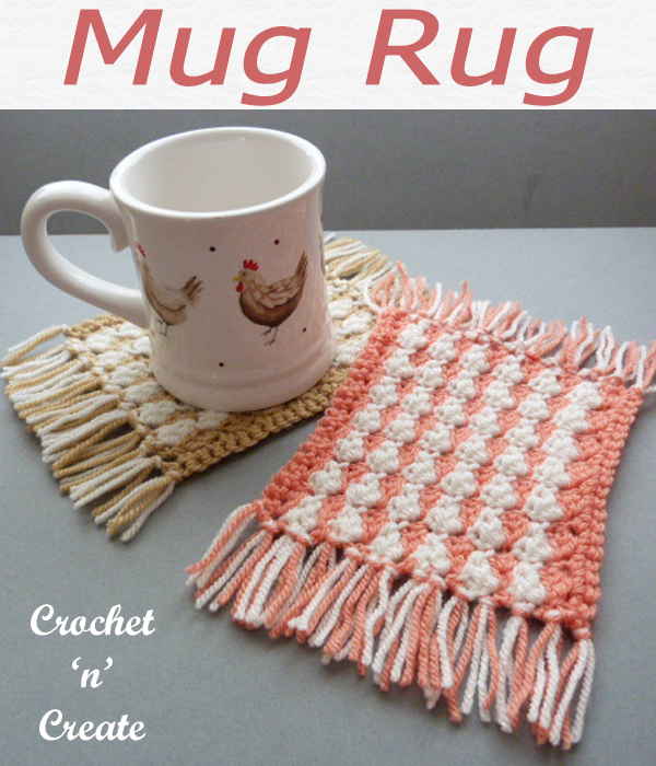 Free crochet mug rug pattern, this easy designs is finished with pretty fringed ends. CLICK and scroll down the page for the pattern. | #crochetmugrug #crochetcoaster #crochetmat #crochetdining #crochetforthehome #crochetmat #crochet #crochetncreate #crochetpattern #freecrochetpattern #easypattern #freepattern #forbeginners #diy #crafts #crochetaddict #followforcrochet