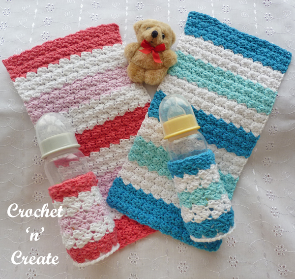 two baby burp cloths and bottle covers