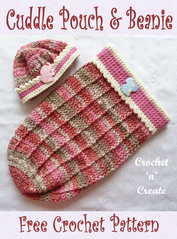 baby cuddle pouch and beanie